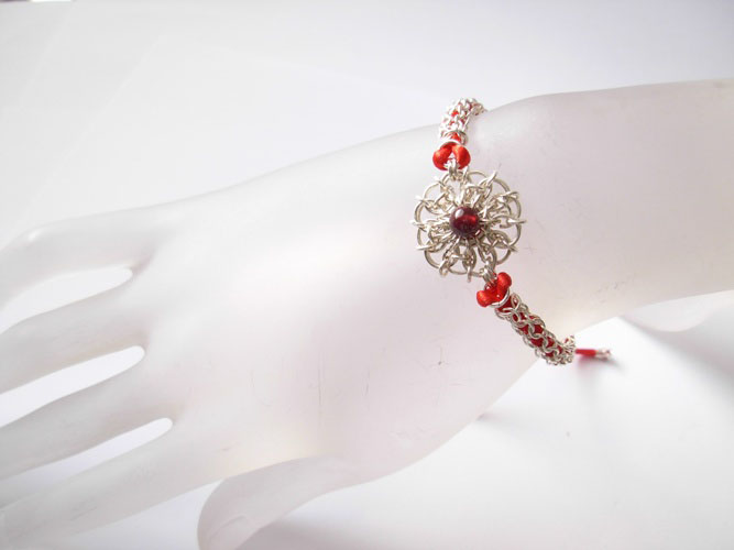 images/root chakra daisy bracelet on hand.jpg